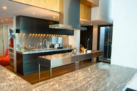 modern kitchen design with black wood and stainless steel full stainless steel island and