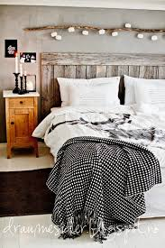 white wood grey bedroom draumesider i like the piece of wood with it looks to be lights hanging off them