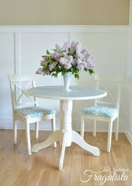 round pedestal dining table makeover with a painted doily the