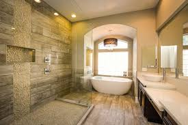 luxury river rock shower with wood grain style porcelain tiles