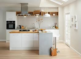 High gloss  Mix wood and other materials with a white kitchen to give a  textured and unique feel