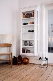 wall mounted glass door shelving unit