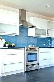 blue kitchen backsplash blue kitchen tile hanging lantern lamp modern black and white gas stove white blue kitchen backsplash sea glass tile