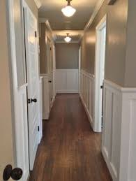 would be pretty in upstairs hallway beautiful wainscoting and crown molding for the hallway wall color sherwin williams pavestone