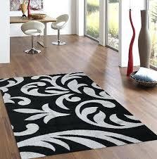 beige living room area rug black red blue brown