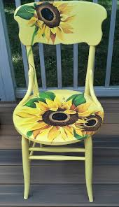 Hand painted and distressed sunflower chair - The link does NOT go to  original site of this chair but it is a great refurbish chair idea,