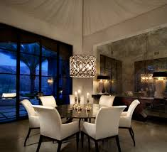 dining room lamps. metal cylinder pendant dining room lighting fixtures with shades over a rounded wooden table and white fabric chairs in modern lamps