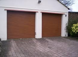 2 x golden oak roller garage doors