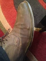 does any know how to get rid of water stains on leather