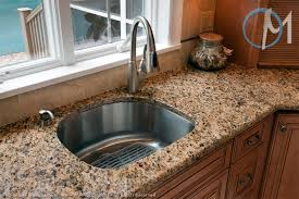 santa cecilia s consistent pattern looks great in this simple and functional sink area