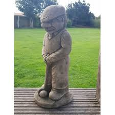 golfer stone sculpture garden stone