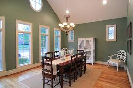 contemporary recessed lighting in dining room with wooden dining table and chandelier lighting