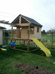 playhouse with swingset