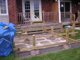 building a wood deck on top of a concrete patio home design ideas regarding dimensions 1552