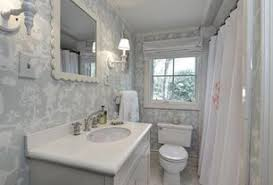 bathroom home design. traditional full bathroom with designer white solid surface countertop, corian, interior wallpaper, limestone home design
