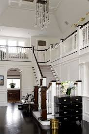 two story foyer with white wainscotting wow so traditional but wait look