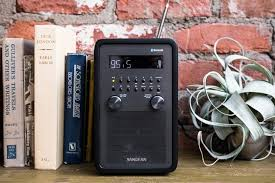 table radio. a standalone version of our upgrade pick for best tabletop radio sitting next to several books table