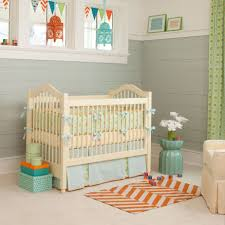 baby bedding ideas white painted wall cream fur rug topper for dresser painted brown woven nursery