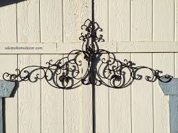 large tuscan wrought iron wall decor is a must have for home decor has unique scrolls with a black gray iron finish made from rust free wrought iron