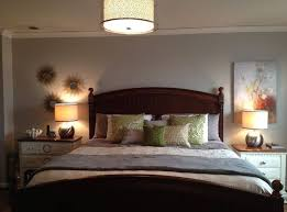 unique bedroom ceiling light with drum shade along with 2 bed lamps