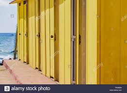 Marvelous Beautiful Yellow Bathing Houses On The Sandy Beach. Empty Shelters On A  Sunny But Moody Day. Seaside Architecture, Colored Paint, Maze Like  Labyrint.