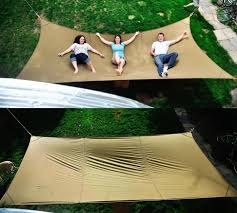 The giant hammock is indeed a mega hammock which spans 15 feet x 8 feet and  can easily fit up to 3 humans, or 1 obese human along with maybe a dog.