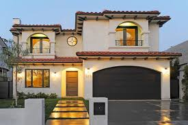 dark brown garage doorsRachel parcell house exterior mediterranean with concrete wall
