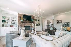 chic living room large shabby with built in shelving brick accent wall a mounted and by