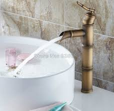 aliexpress com deck mounted antique brass bamboo style bathroom faucet single handle vessel sink waterfall mixer taps wnf107 from reliable waterfall
