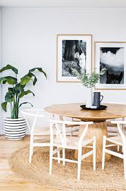 modern dining room with wood pedestal table via coco kelley