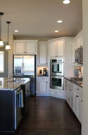 dark brown hardwood floors. Kitchen Dark Wood Brown Hardwood Floors White Cupboards Grey Walls Modern