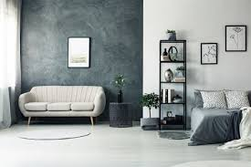 white room with charcoal accent wall and decor