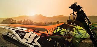 orange and black mx seat cover on ktm