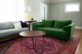 colorful living room refresh green couch and pink rug and then rugs to go with green sofa