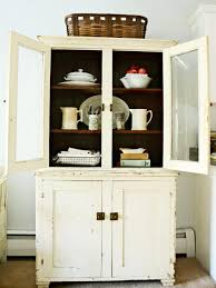 vintage kitchen hutch with natural wood shelves