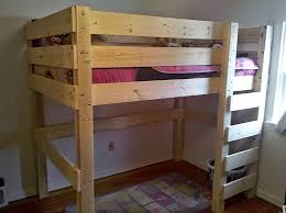 a wooden loft bed with a ladder