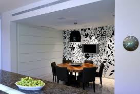 lighting adds to the appeal of the striking black and white wallpaper in the dining room