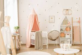 Nursery with white furniture Brown Stock Photo Sweet Spacious Nursery Room Interior For Baby Girl With White Furniture Pastel Pink Decorations And Golden Polka Dot Wallpaper 123rfcom Sweet Spacious Nursery Room Interior For Baby Girl With White