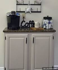 white painted cabinets with granite countertop