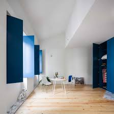 home office dark blue gallery wall. Minimalist White Living Space With Blue Window Shutters | NONAGON.style Home Office Dark Gallery Wall