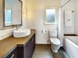white beveled subway tile bathroom blue wall paint rectangular art paper painting cylinder classic crystal bottle