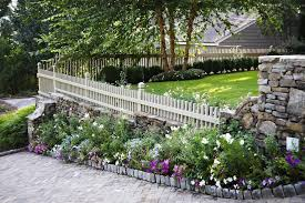 Landscape fencing ideas landscape traditional with perennial garden flower  bed stone wall