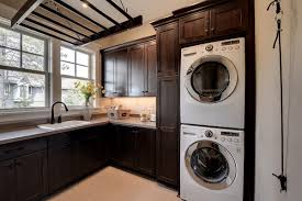 modern laundry room cabinets and practical storage solutions