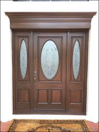 picture of a set of front doors painted to look like wood in wellington fl