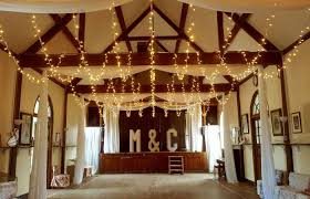 a village hall can be a wonderful space for a wedding reception but they often benefit from a few extra touches to liven them up and to disguise some of