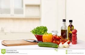 kitchen table with food. Vegetables, Spices And Kitchenware On Table Kitchen With Food A