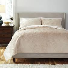 patterned golden beige coverlet set