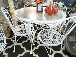 round wrought iron patio dining table