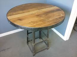 round oak table with metal accents 325 i bring new life to vintage finds i found some welded steel stools very heavy and industrial looking