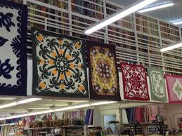 quilt shops | I Finally Have Time & Hawaiian Quilts hanging at Fabric Mart Adamdwight.com